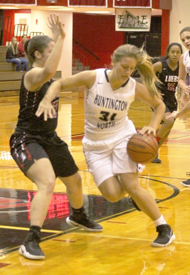 Huntington North junior Rylee Williams maneuvers in tight with the ball against a Bishop Luers defender in action at North Arena Tuesday night, Nov. 28. The Lady Vikings lost, 62-51.