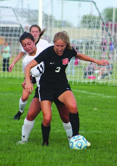 Gaining control over the ball at the Thursday, Sept. 3, girl's varsity soccer game is Huntington North High School  senior Addy Wiley. The girls' varsity soccer team won 2-0 against their Manchester opponents that evening.