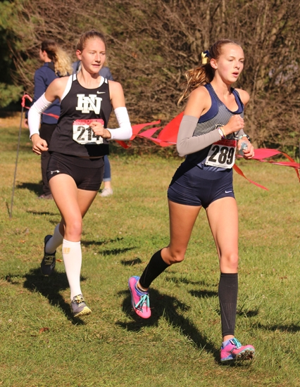 Huntington North sophomore Addy Wiley (left) competes in the Marion Girls' Cross Country Sectional on Saturday, Oct. 12, at Indiana Wesleyan in Marion. Wiley won the individual title to lead the Lady Vikes to second place, good enough to qualify them for regional next week.