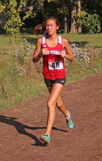 Huntington North sophomore Hanna Whitney churns her way to sixth place at the Marion Girls' Cross Country Sectional on Saturday, Oct. 6, at Indiana Wesleyan University. The Lady Vikings placed second as a team to earn advancement to regional next week, also at IWU