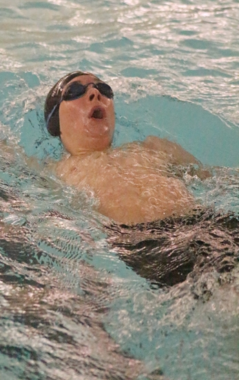 Aidan Miller, a junior on the Huntington North High School boys' swim team, competes in the 200-yard individual medley during a meet against visiting Bellmont on Tuesday, Dec. 12. The Vikings lost, 110-49.