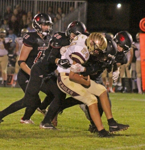 The Huntington North defense stacks up Columbia City running back Jacob Wigent in action at Kriegbaum Field on Friday night, Sept. 8. The Vikings lost, 20-10.