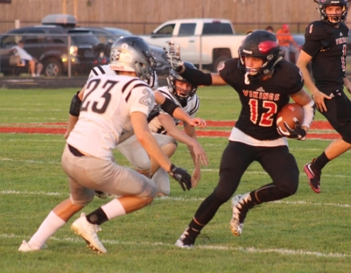 Richard Gutierrez (right), a senior wide receiver on the Huntington North High School varsity football team, prepares to stiff-arm defensive back Aidan Friedel (left) during a game against DeKalb at Kriegbaum Field on Friday, Sept. 22. The Vikings lost, 41-23.