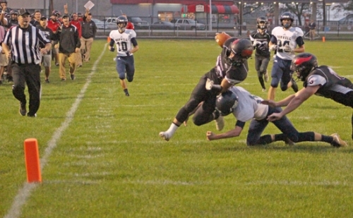 Brock Eltzroth, a senior on the Huntington North High School varsity football team, gets tackled after making an interception and returning it to Norwell's two-yard line during a game on Friday, Oct. 5, at Kriegbaum Field. Eltzroth finished with two interceptions and the Vikings dispatched the Knights, 17-7.