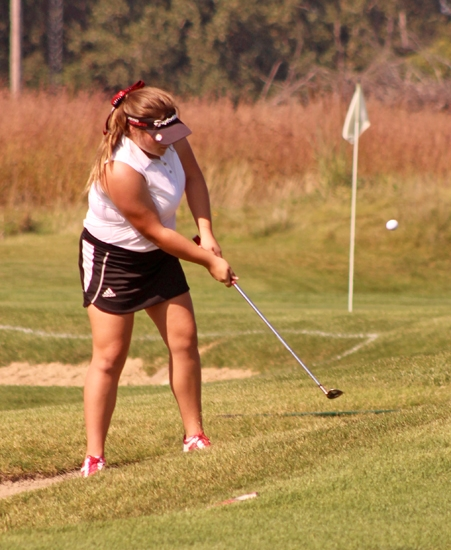 Laura Ham, a junior on the Huntington North High School girls' golf team, chips onto the green on the first hole at Noble Hawk Golf Links, in Kendallville, during the East Noble Regional on Saturday, Sept. 23. The Lady Vikings placed 10th with a score of 357 and did not qualify for state.