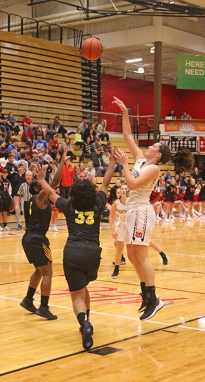Maddy Robrock (right), a senior on the Huntington North High School girls' varsity basketball team, shoots the ball over a pair of defenders from visiting Snider during a game on Tuesday, Nov. 6. The Lady Vikings fell to the Lady Panthers, 53-46.