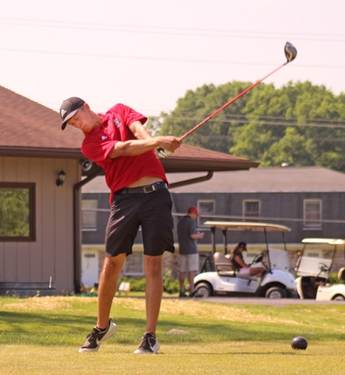 Huntington North golfer Daniel Shivley rips into a tee shot at the Warsaw Boy's Golf Sectional on Saturday, June 2, at Rozella Golf Course.