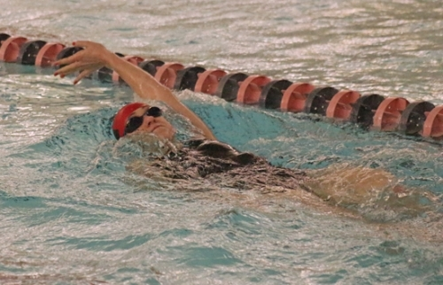 Adalyn Harvey, a freshman on the Huntington North High School girls' swim team, swims the backstroke portion of the 200-yard individual medley during a meet against visiting Bellmont on Tuesday, Dec. 12. The Lady Vikings narrowly lost, 87-83.