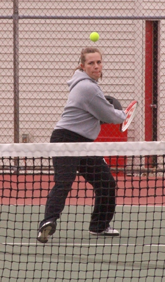 Braxtyn Maroney, a senior on the Huntington North High School girls' varsity tennis team, focuses on the ball during her match at second doubles against a twosome from visiting Peru on Tuesday, April 10. Maroney and partner Leann Ringenberg dominated their match, 6-0, 6-1, as the Lady Vikings won their season opener, 4-1.
