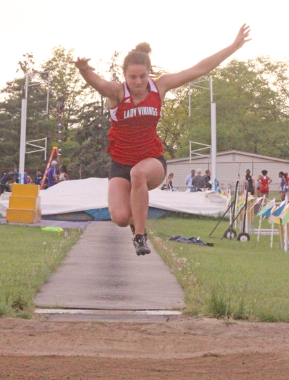 Laora Pampaloni, a junior on the Huntington North High School girls' track team, soars through the air as she competes in long jump at the New Haven Sectional on Tuesday, May 15. With a leap of 14-10.50, Pampaloni placed third in the event and advanced to the Marion Regional for the Lady Vikings, who finished second at the meet as a team.