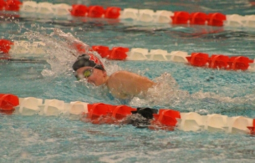 Huntington North junior Laney Shaw churns for the wall in a fifth place effort in the 100-yard freestyle at the Warsaw Girls' Swim Sectional on Saturday, Jan. 2.