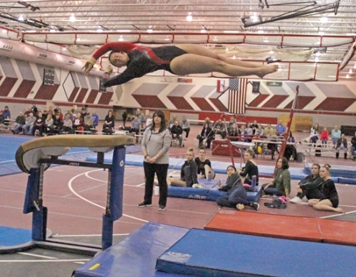 Huntington North gymnast Laora Pampaloni flies through the air on vault in action against visiting Wawasee on Thursday, Feb. 15. Pampaloni won the event,but HNHS lost the meet.