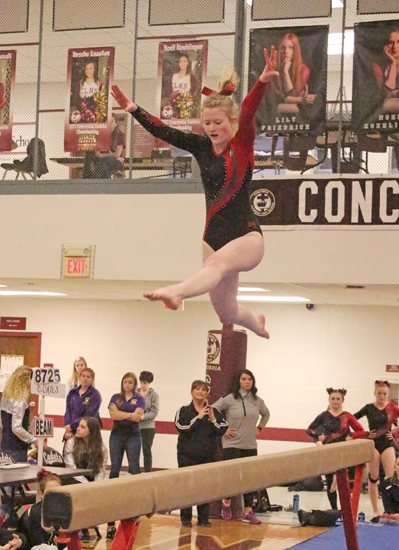 Huntington North senior Sarah Malone grabs a lot of air over the balance beam at the Concordia Lutheran Gymnastics Sectional on Saturday, Feb. 24.