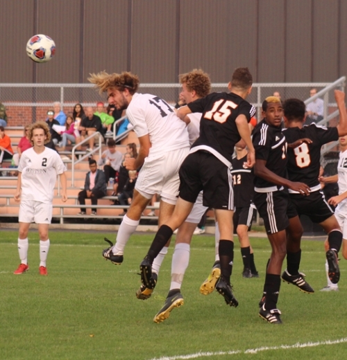Goalkeeper Sam Poling, a senior on the Huntington North High School boys' soccer team, makes a diving save during a game against Warsaw in the semifinals of the Warsaw Sectional on Wednesday, Oct. 4. Poling recorded 11 saves, but the Vikings fell to the Tigers, 3-0, bringing the season to an end.