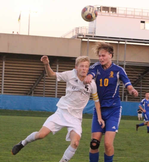 Huntington North's Peyton Miller (left) and Homestead's Jordan Cassedy collide while leaping to head the ball during the Homestead Boys' Soccer Sectional championship game on Monday night, Oct. 8, at Warsaw. The Vikings lost, 5-1.