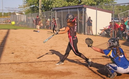 Lady Viking Erika Vinson drives in two runs with a single against Homestead in the Homestead Softball Sectional on Thursday night, May 23. The Lady Vikings lost, 12-9, to end their season.