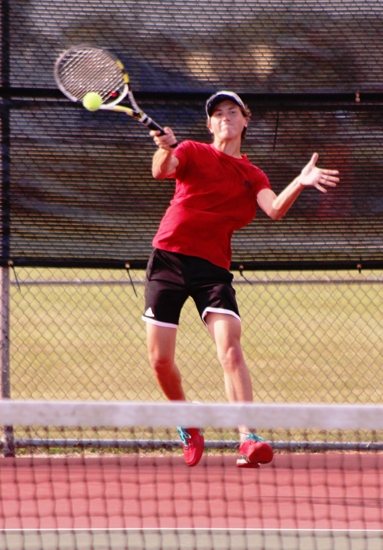 Adam Zahm, one half of the second doubles team for the Huntington North High School boys' varsity tennis team, returns a shot in a match against visiting Leo on Tuesday, Sept. 12. Zahn and his partner, Jarrett Gray, lost in three sets as the Vikings got shut out, 0-5.