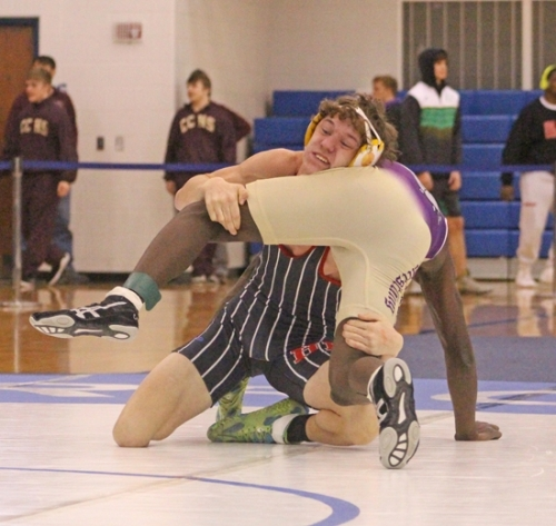 Huntington North's 145-pound wrestler, battles an opponent during regional action Saturday, Feb. 2, at the Carroll Wrestling Regional. Kline placed fourth in his weight class to be of eight Vikings to move on to next week's New Haven Semi-state.
