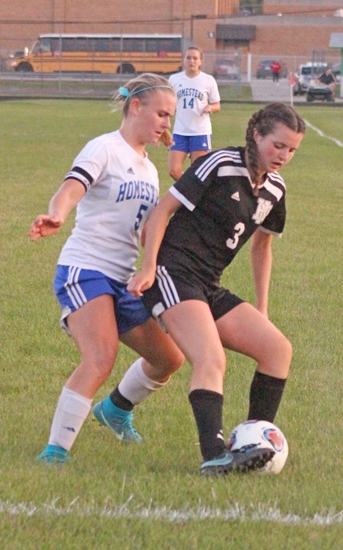 Huntington North's Hannah Tillett is marked closely by Homestead defender Olivia Cronenwett during action at the Fort Wayne South Side Soccer Sectional semifinal on Thursday, Oct. 5. The game went to a shootout before Huntington North came out on top, 3-2.