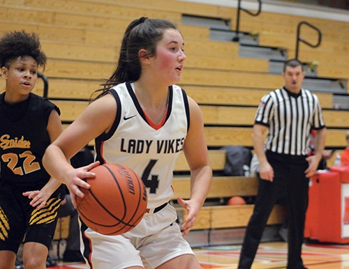 Looking for a teammate to pass the ball to is Huntington North High School girls' varsity basketball player Reece Colclesser. HNHS hosted Snider High School on Friday, Nov. 13, with a limited fan base due to COVID-19.