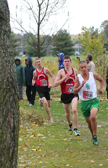 Huntington North's Austin Lange (middle) and teammate Matt DeWitt (left) round a corner behind South Side's Michael Barrera at the Marion Boys' Cross Country Regional at Indiana Wesleyan University on Saturday, Oct. 19.