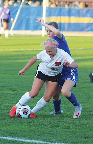 Attempting to  keep the ball in fair territory is  Huntington North High School soccer player Skylar Olson. HNHS traveled to Homestead High School on Tuesday, Oct. 6,  for sectional play against Homestead HS.