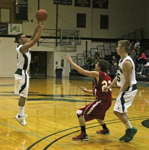 HU guard Ryan Boester fires a 3-pointer over the defense of Trent Murray of Indiana-Kokomo on Saturday, Dec. 22, at Platt Arena in the Foresters' 102-60 win.