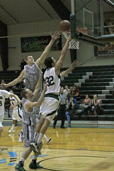 Huntington University's T.J. Short goes strong to the hoop despite the defensive efforts of Zach Zeltman of Mount Vernon Nazarene on Saturday, Jan. 5.