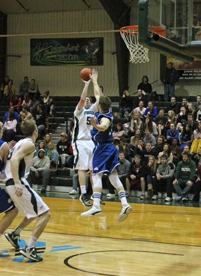 Huntington University forward Shane Merryman launches a jumper over the defense in the Foresters' 61-59 win over visiting Bethel on Tuesday, Feb. 5.