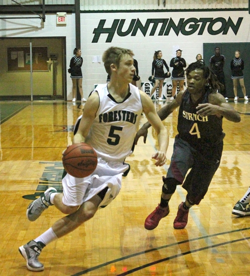 Huntington University guard Stephen Jones heads toward the basket against the defense of Cardinal Stritch's Mike Simpson on Saturday afternoon, Nov. 10, at HU in the Ness Bros. Hall of Fame Baketball Tournament.