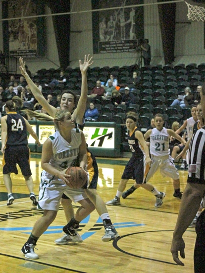 Huntington University's Taylor Foley goes toward the hoop in play against visiting Srping Arbor University on Tuesday, Jan. 8. Foley scored eight points as HU won 60-44.