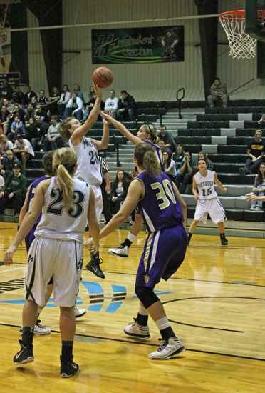 Huntington University forward Amellia Recker shoots over the Taylor defense in the Foresters' 70-65 win on Saturday, Jan. 12, at Platt Arena.