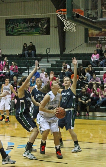 Huntington University forward Amelia Recker (center) contemplates putting up a shot while bracketed by defenders from visiting Mount Vernon Nazarene University during a game on Saturday, Feb. 2. The Foresters won 55-51.