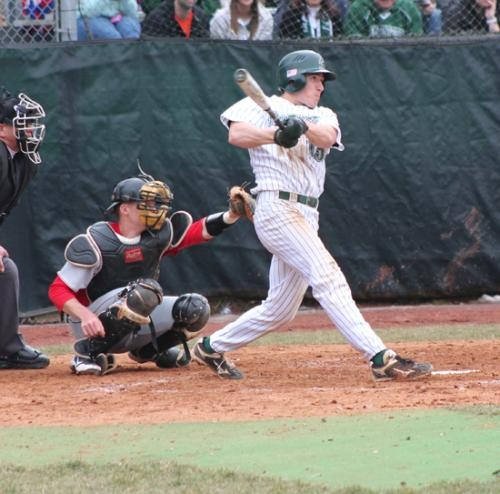 Huntington University's Blake Ayers watches the flight of his home run in the first game of a doubleheader sweep over visiting Grace College on Saturday, March 30.