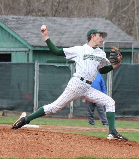Huntington University pitcher Xyan Adkisson launches a pitch against visiting Bethel College in the first game of a doubleheader on Monday, April 15. Adkisson teamed with Brian Kirschbaum on a five-hit shutout.