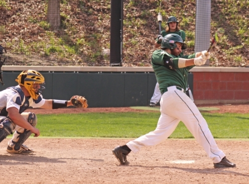 Forester shortstop Adam Roser takes a mighty swipe at a baseball in action Saturday, April 15, against visiting Marian. The Foresters split a doubleheader.