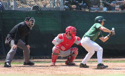 Jared Green (right), a freshman on the Huntington University baseball team, looks to lay down a bunt in the Foresters' first game against visiting Indiana Wesleyan on Saturday, April 19. HU defeated the Wildcats, 4-2, but lost the second game, 7-1.