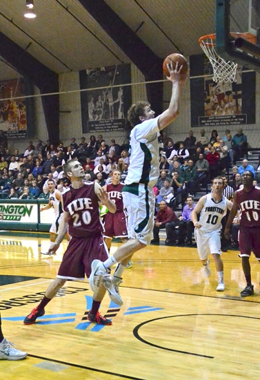 Huntington University forward Shane Merryman flies past an indiana University East defender on his way to a bucket in the Foresters' 102-76 win in the championship game Saturday of the Ness Bros. Hall of Fame Classic.