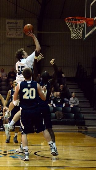 Huntington University forward Shane Merryman rises above th crowd for a short shot on his way to scoring 34 points against visiting Trinity Christian College on Tuesday, Nov. 12.