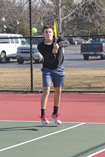 Huntington University tennis player Diego Inurritegui, a freshman, eyes the ball while playing at second doubles for the Foresters against visiting Indiana Tech on Friday, March 22.