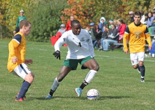 Huntington University soccer play Bradley Kamden maneuvers with the ball against visiting Marian University on Saturday, Oct. 6. Kamden scored a goal and had an assist as HU won 3-1.