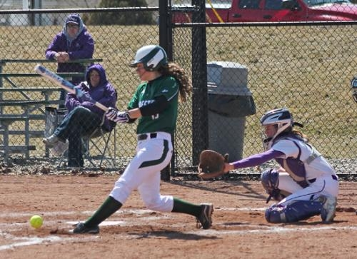 Huntington University's Kaitlyn Troyer fouls the ball off in the bottom of the fifth inning of the softball team's game against visiting Olivet Nazarene University on Saturday, March 23.