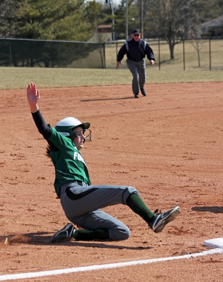 Huntington University's Bailey McIntire slides safely into third base during the first game of the softball team's doubleheader against visiting Mount Vernon Nazarene University on Friday, March 29. The Foresters lost the game but won the second one.