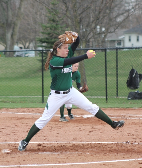 Huntington University junior pitcher Marcie McDougle winds up for a pitch in the first game of a doubleheader against Saint Francis on Monday, April 15.