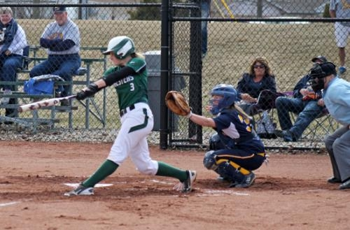 Lindsay Shellabarger (left), a senior on the Huntington University softball team, takes a swing in the Foresters' first game against visiting Marian in a doubleheader on Monday, March 31.
