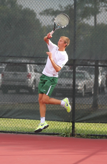 Huntington University's Vlad Khudziy is more than a little airborne during the number one doubles match he and Jose Hungria played on Tuesday, Sept. 17, against visiting Spring Arbor University.