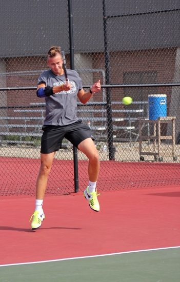 Huntington University men's tennis player Vlad Khudziy strikes the ball back to his opponent in first singles play against visiting Indiana Tech on Saturday, Sept. 29. The Foresters won 6-3.