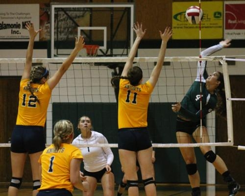 Heather Medich (right), a junior on the Huntington University volleyball team, elevates for the spike as two defenders go for the block during a match against visiting Marian University on Saturday, Sept. 21. The Foresters lost 18-25, 21-25, 26-28.