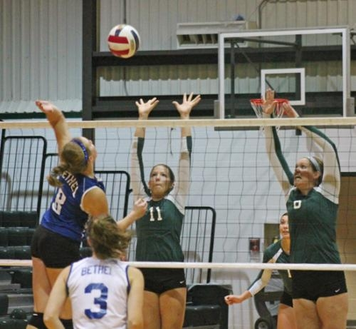 Abbey Keister (center) and Huntington North alum Melissa Grossman (right) elevate to block Christina Welch's spike during action between the Huntington University volleyball team and visiting Bethel College on Saturday, Sept. 15.