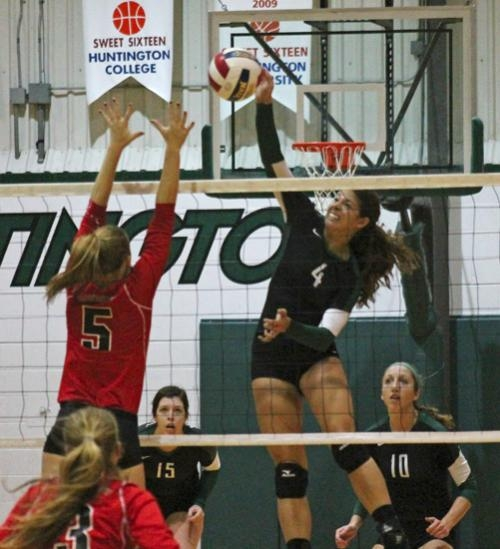 Huntington University volleyball player Heather Medich (right) goes up to slam the ball down in the team's contest against visiting Davenport University in the Huntington University Tri-Match on Saturday, Sept. 29. The Foresters lost 1-3.